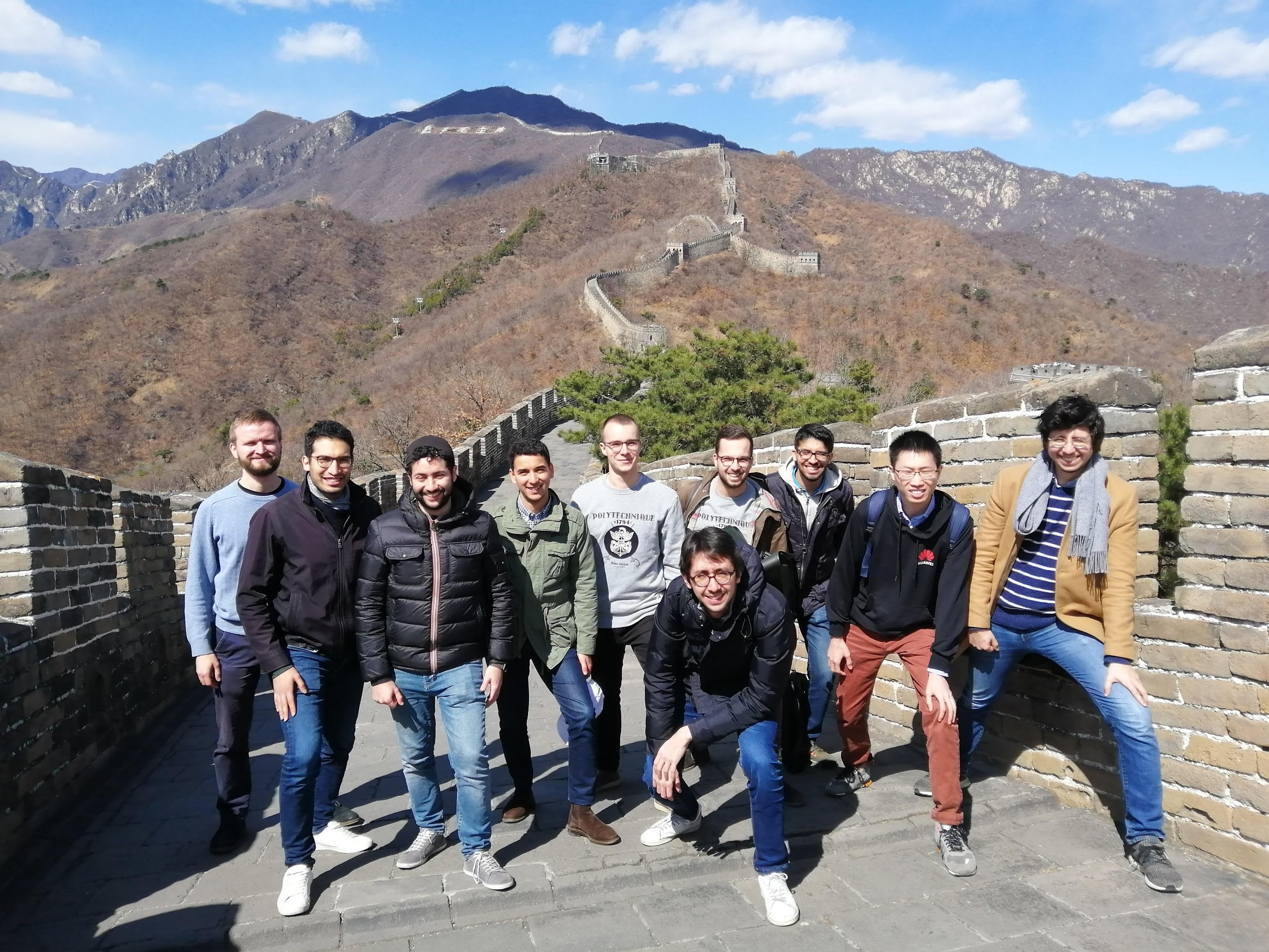 The finalists of the Huawei Big Data Challenge 2018 on the Great Wall in China.